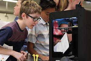 Student exploring a 3D printer