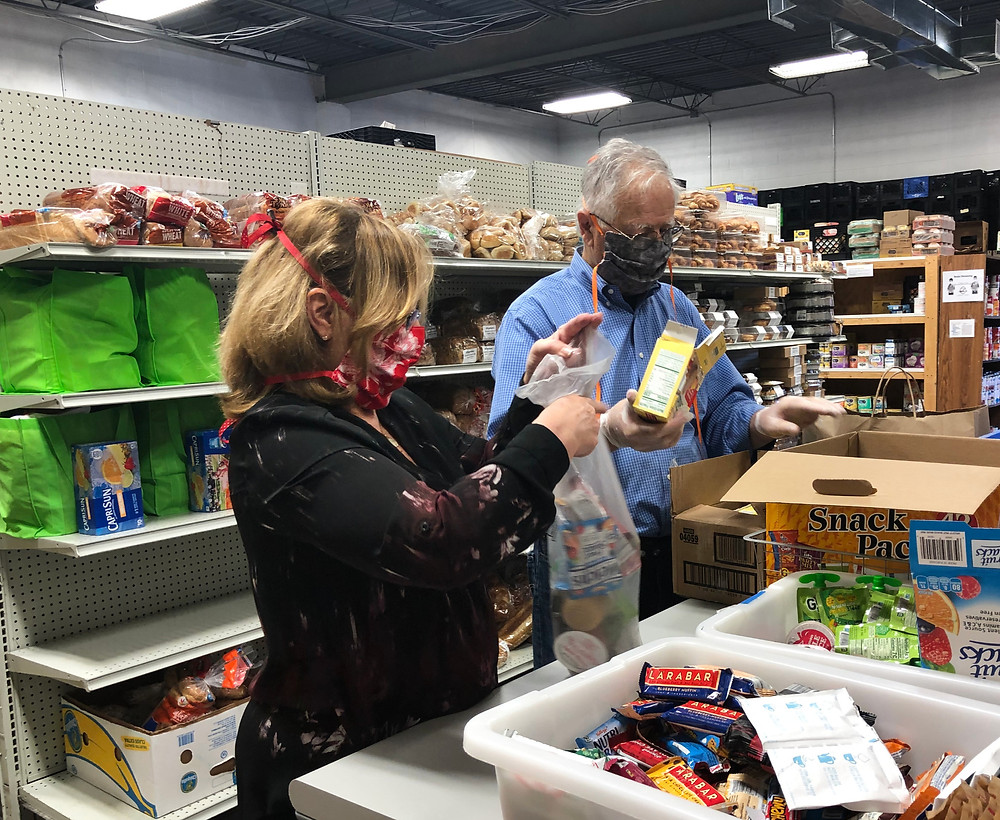 Volunteers sort items for bags at Western Fairfax Christian Ministries.
