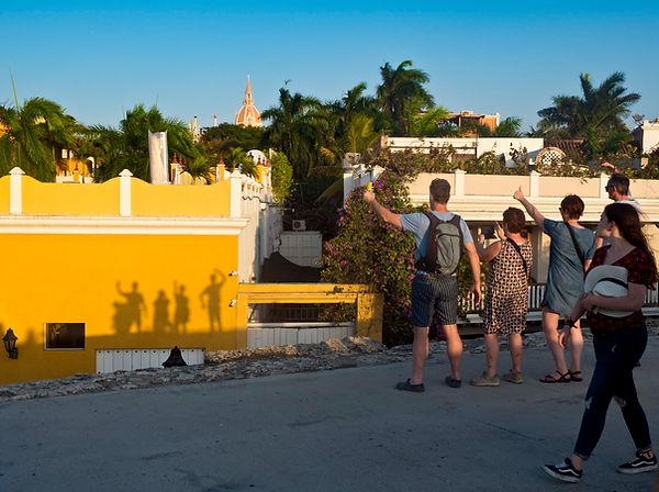 visitors making wall shadows, Juan Valdez coffee shop interior, Bocagrande, Cartagena, Colombia.jpg.jpg