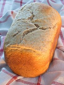 loaf of bread made with organic whole wheat and dark rye flour