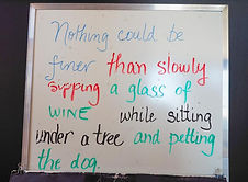 sign promoting wine and dogs, Sue-Ann Staff Estate Winery, Jordan, Ontario, Canada