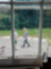 2 boys waving