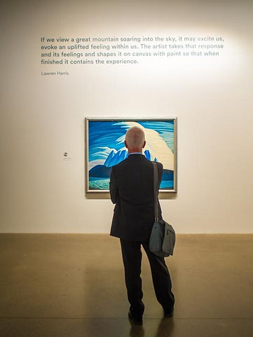man viewing painting by Lawren Harris, AGO exhibit: The Idea of North