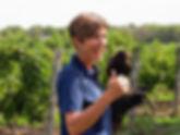 Winemaker Louise Engel and Harris hawk 'Amadeus', Featherstone Winery, Jordan, Ontario, Canada