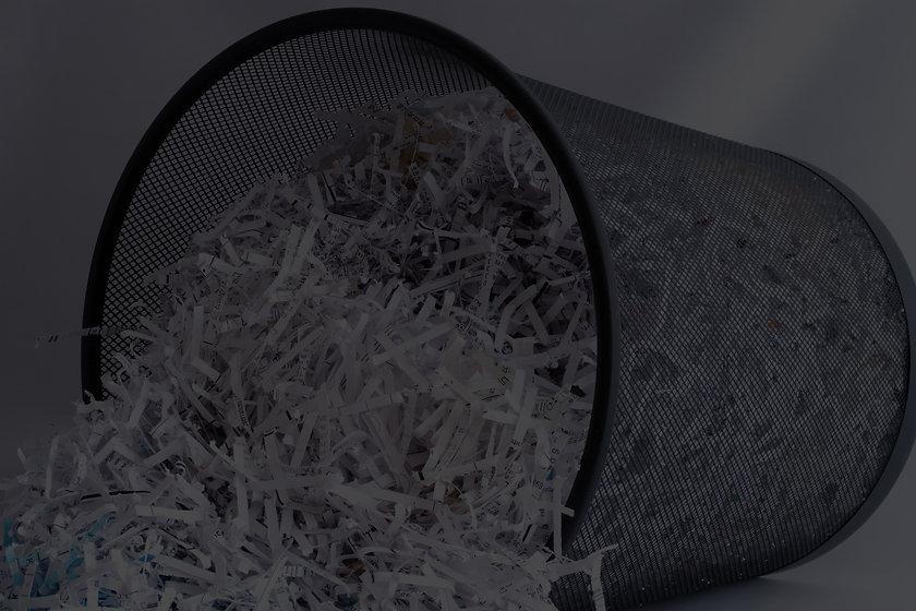 Shredded%20Paper%20in%20Waste%20Basket_edited.jpg