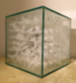 White cube, a sculpture made of glass and feathers