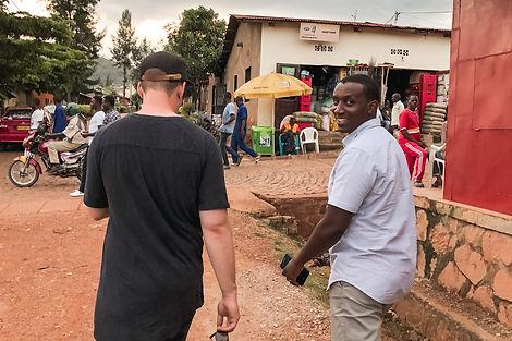 Shelby & James walking into a market into Rwanda.