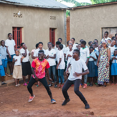 Group of dancing young adults in a small village outside Kigali