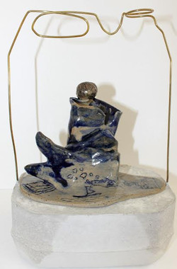 'Life in a barrel'; ceramic on a cement
