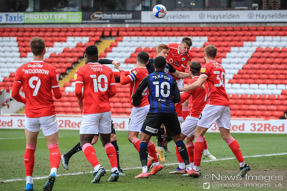 Mads Juel Andersen #6 of Barnsley heads clear from a corner