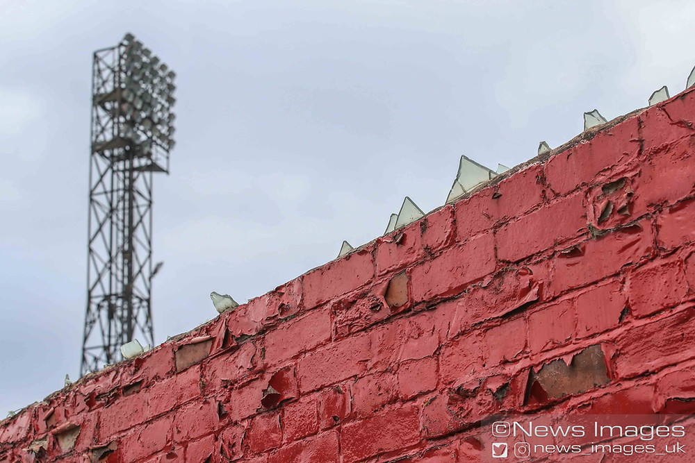 Remnants of a bygone era as glass shards line the top of the West Stand at Oakwell