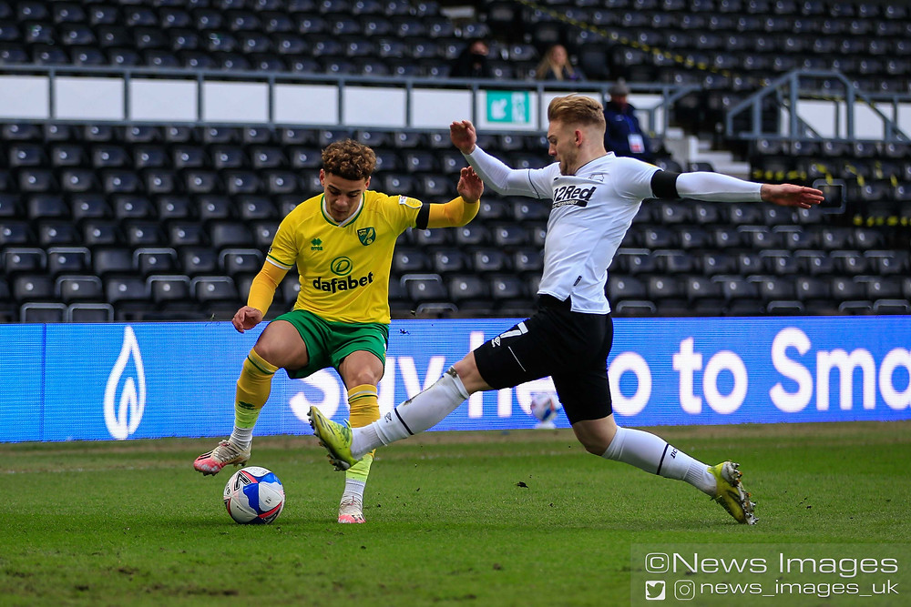 Max Aarons #2 of Norwich City and Kamil Jozwiak #7 of Derby County challenge for the ball