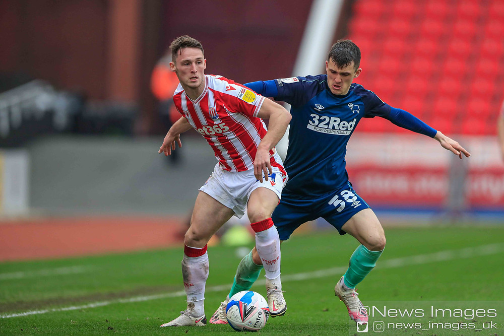 Jordan Thompson #34 of Stoke City and Jason Knight #38 of Derby County challenge for the ball