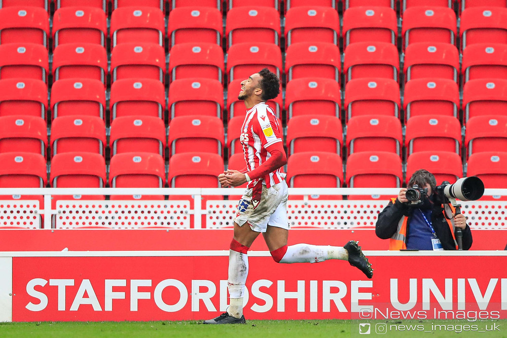 CELEBRATION Jacob Brown #18 of Stoke City   celebrates scoring to make it 1-0 in the 74th minute