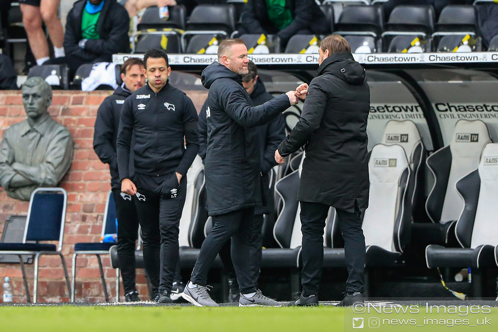 Wayne Rooney the Derby County Manager and Daniel Farke the Norwich City Manager touch fists at the end of the game