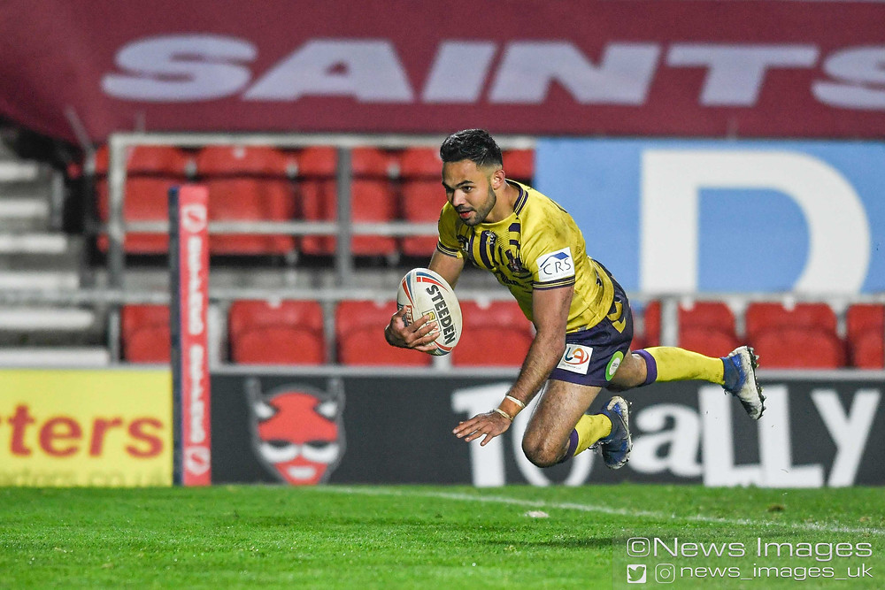 Bevan French #6 of Wigan Warriors goes over for a try