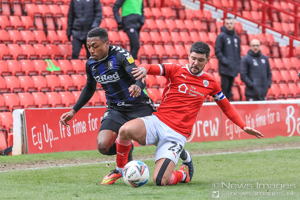 Darnell Fisher #20 of Middlesbrough is fouled by Alex Mowatt #27 of Barnsley