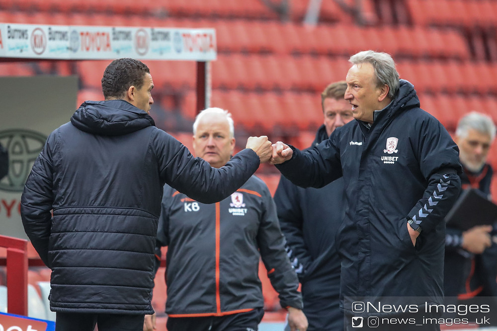 Neil Warnock manager of Middlesbrough bumps fists with Valérien Ismaël manager of Barnsley after Barnsley win 2-0