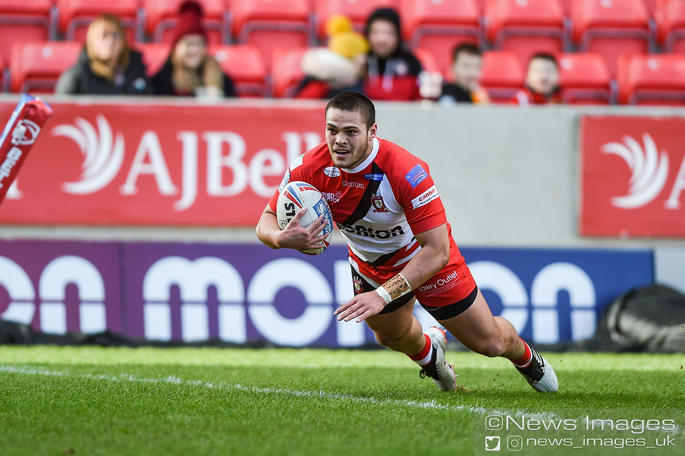 Tui Lolohea #6 of Salford Red Devils goes in for a try