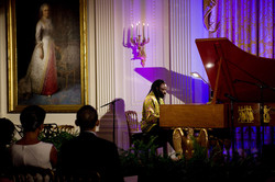 1280px-Michelle_and_Barack_Obama_listening_pianist_Awadagin_Pratt