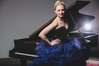Kara Huber has nominated on 2017 Grammy, and had  solo recital in Carnegie Hall