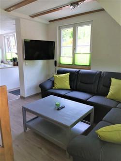 Wohnzimmer mit Sitzecke_Dachsbau