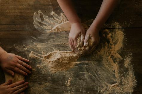 Kid's making pizza dough