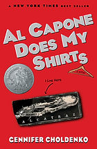 Red book cover with image of a clothes hanger, Alcatraz Prison island and an 'I live here' label.