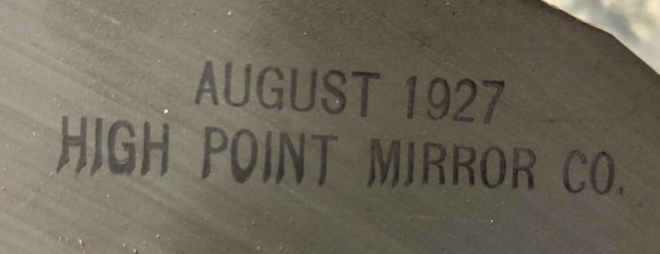 Back of the mirror stamped with the date.