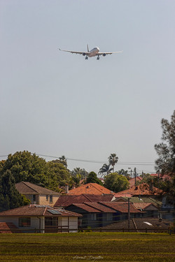 A-Plane-Above-Houses
