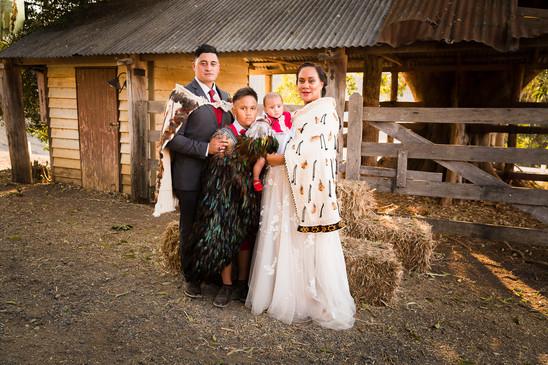 Moses family wearing traditional Maori 'Korowai'