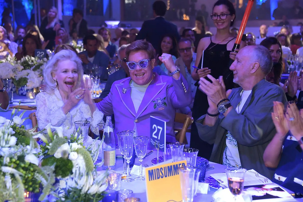 Elton John winning auction item at the EJAF Midsummer gala