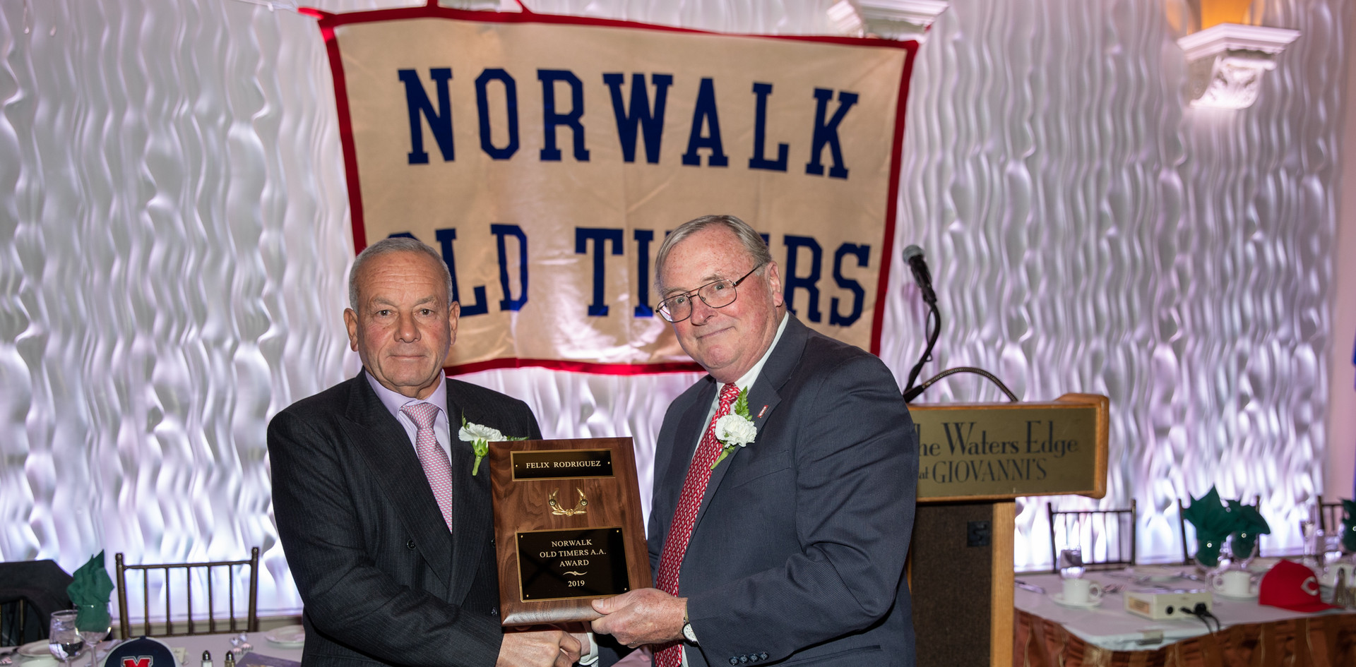 Felix Rodriguez receives his award-commemorating plaque from Norwalk Old Timers Association president Jack Couch.  (photo by Josh Molaver)