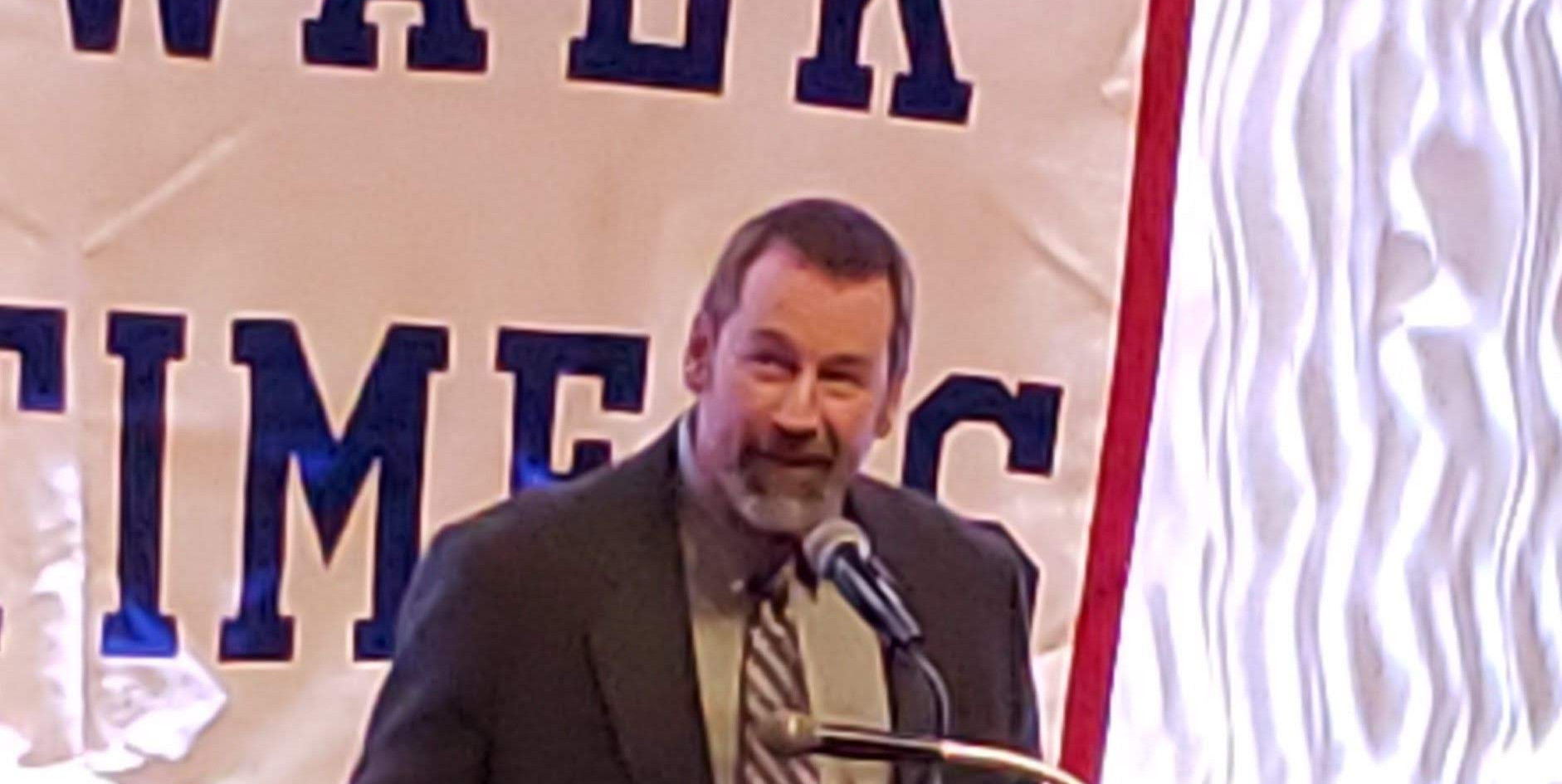 """LAC president John """"Skip"""" D'Amato accepts the Mike Errico Award on behalf of honoree Laurel Athletic Club, celebrating 100 years as a Norwalk athletic presence.  (photo by Anna Mastrolillo)"""