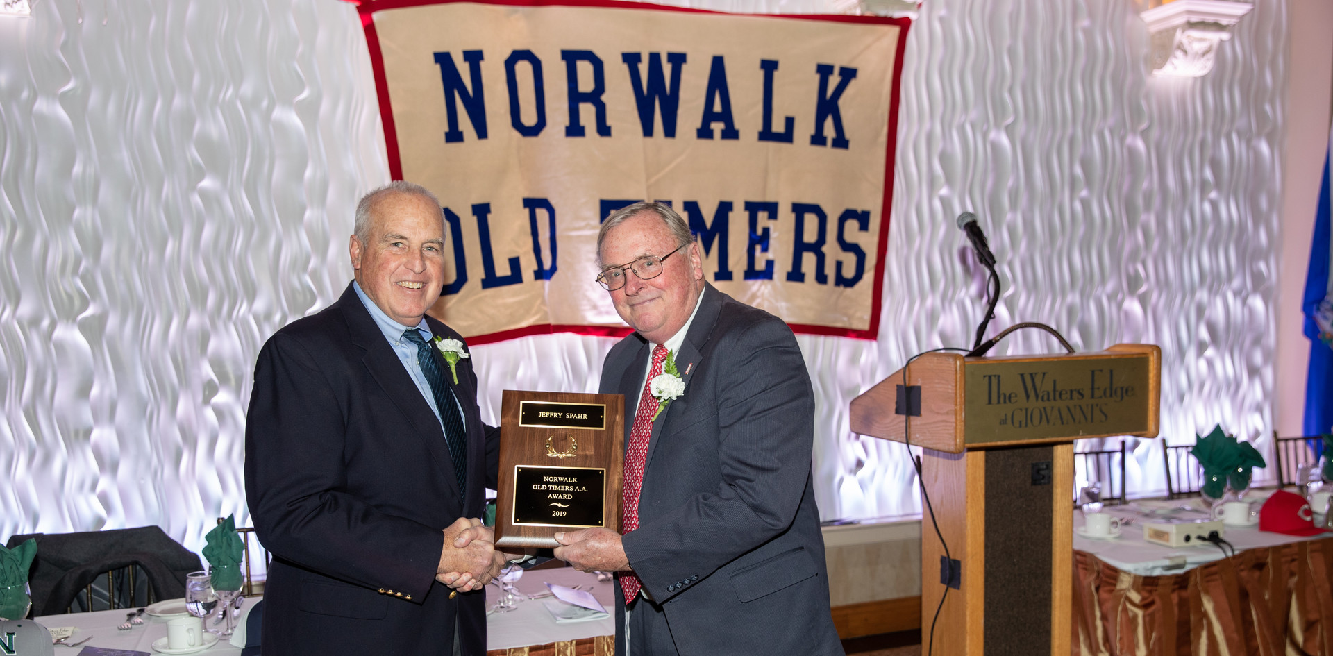 Jeff Spahr receives his award-commemorating plaque from Norwalk Old Timers Association president Jack Couch.  (photo by Josh Molaver)