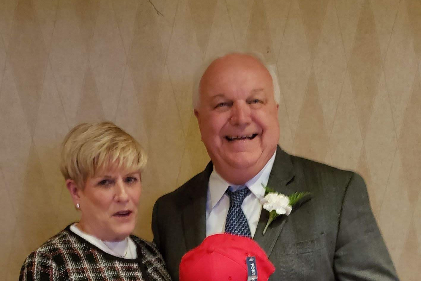 Bob Kramer with his wife Pat holding the hat of his high school alma mater, Central Catholic High School.  (photo by Anna Mastrolillo)