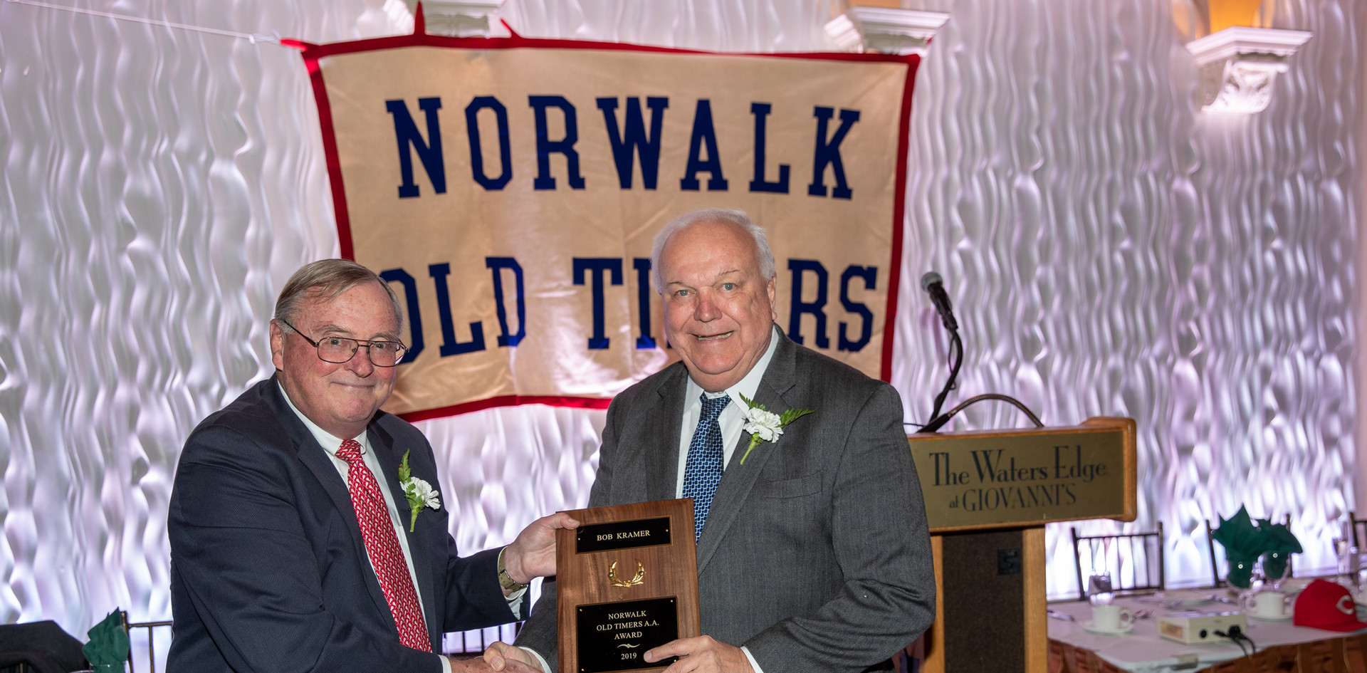 Bob Kramer receives his award-commemorating plaque from Norwalk Old Timers Association president Jack Couch.  (photo by Josh Molaver)