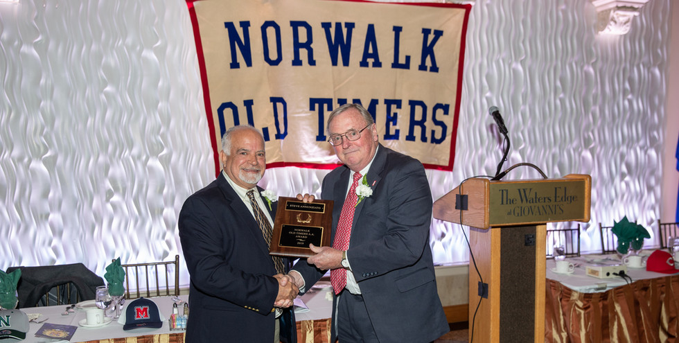 Steve Annunziato receives his award-commemorating plaque from Norwalk Old Timers Association president Jack Couch.  (photo by Josh Molaver)