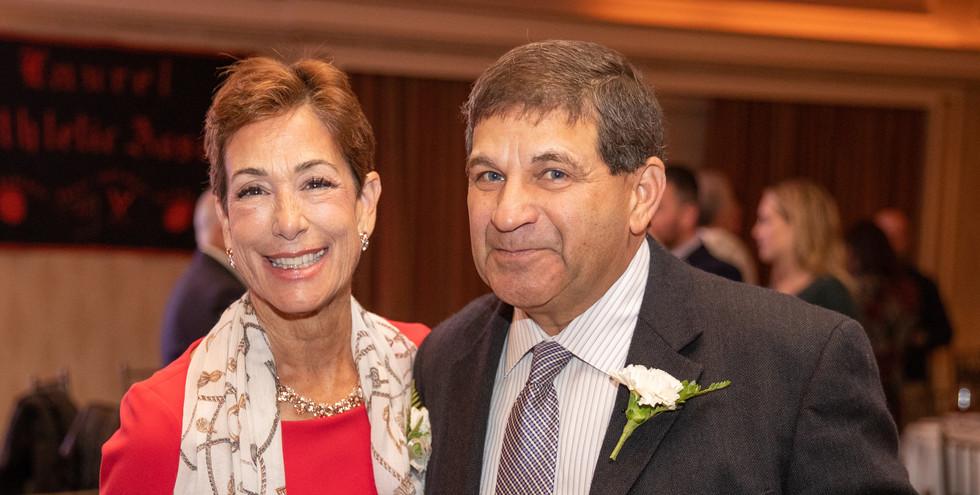 2019 Honoree Maria Marino swaps stories with 2013 honoree and retired Brien McMahon High School baseball coach Joe Madaffari.  (photo by Josh Molaver)