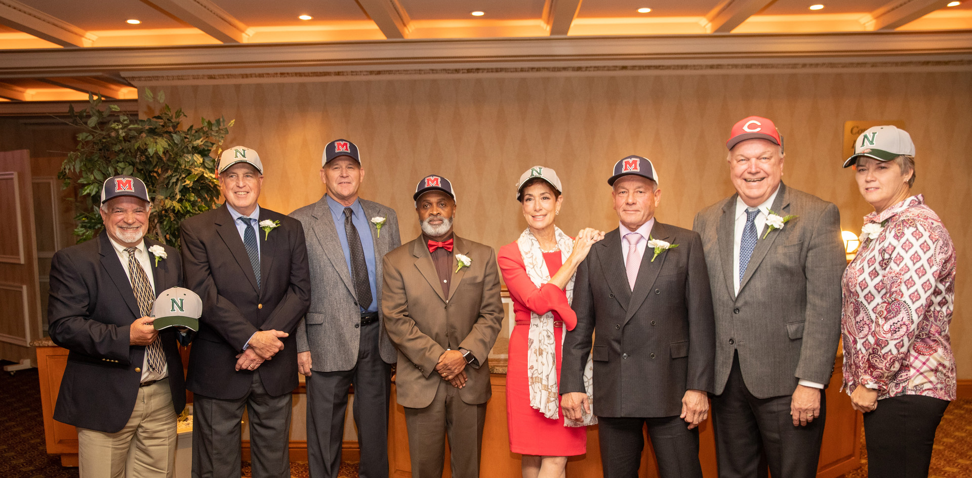 2019 Norwalk Old Timers honorees donned baseball hats that reflected the local high schools at which their athleticism first excelled.  (photo by Josh Molaver)