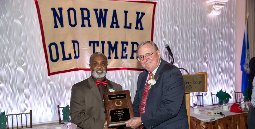 Harry Welfare receives his award-commemorating plaque from Norwalk Old Timers Association president Jack Couch.  (photo by Josh Molaver)