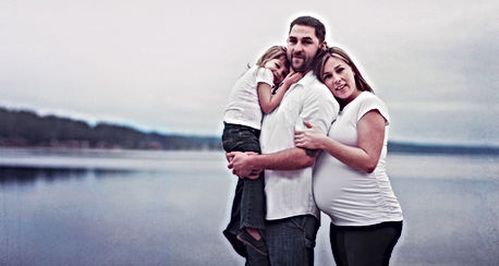 Pregnant woman with family