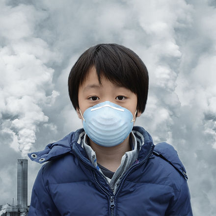Asian boy wearing mouth mask against air pollution_edited.jpg