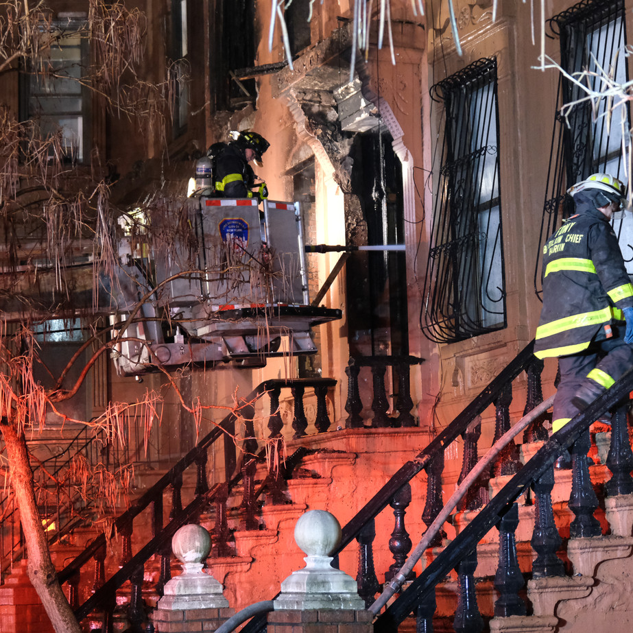 Firefighters working to extinguish a Brownstone fire in Brooklyn, NY