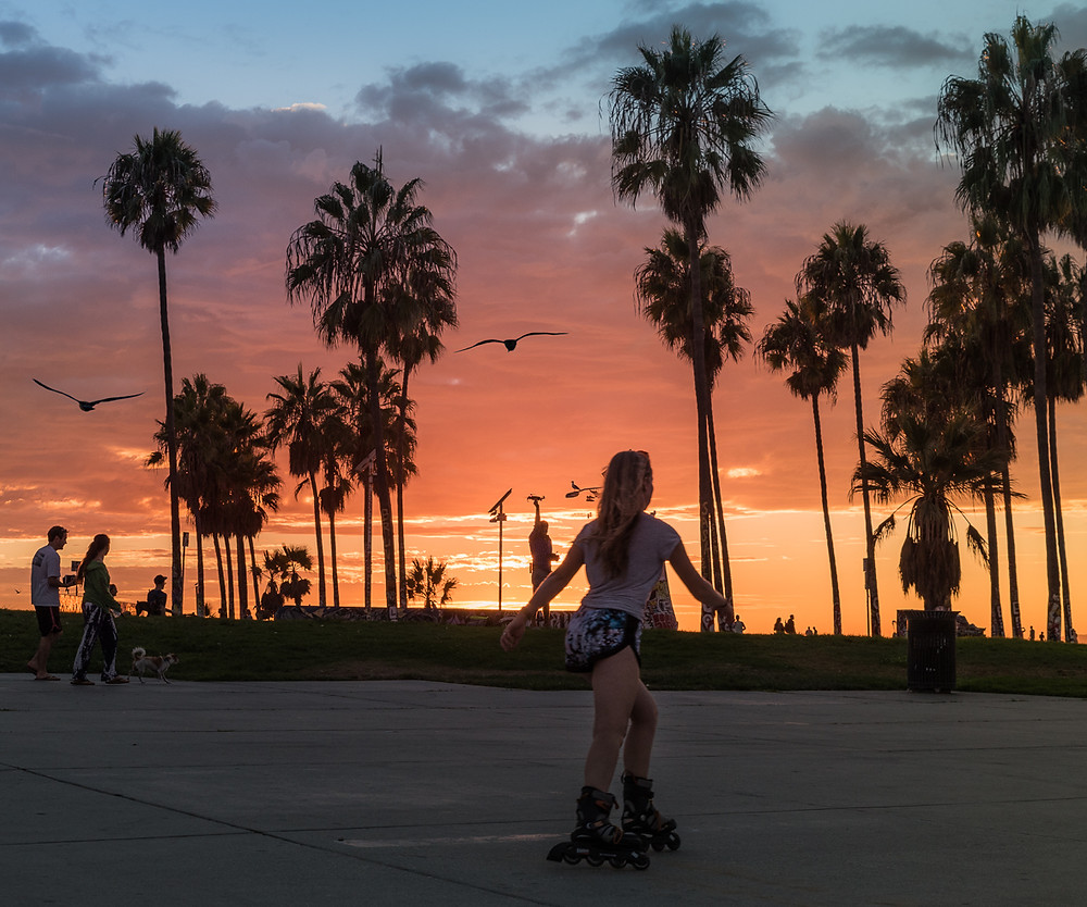 girl rollerblading in Venice Beach California at sunset