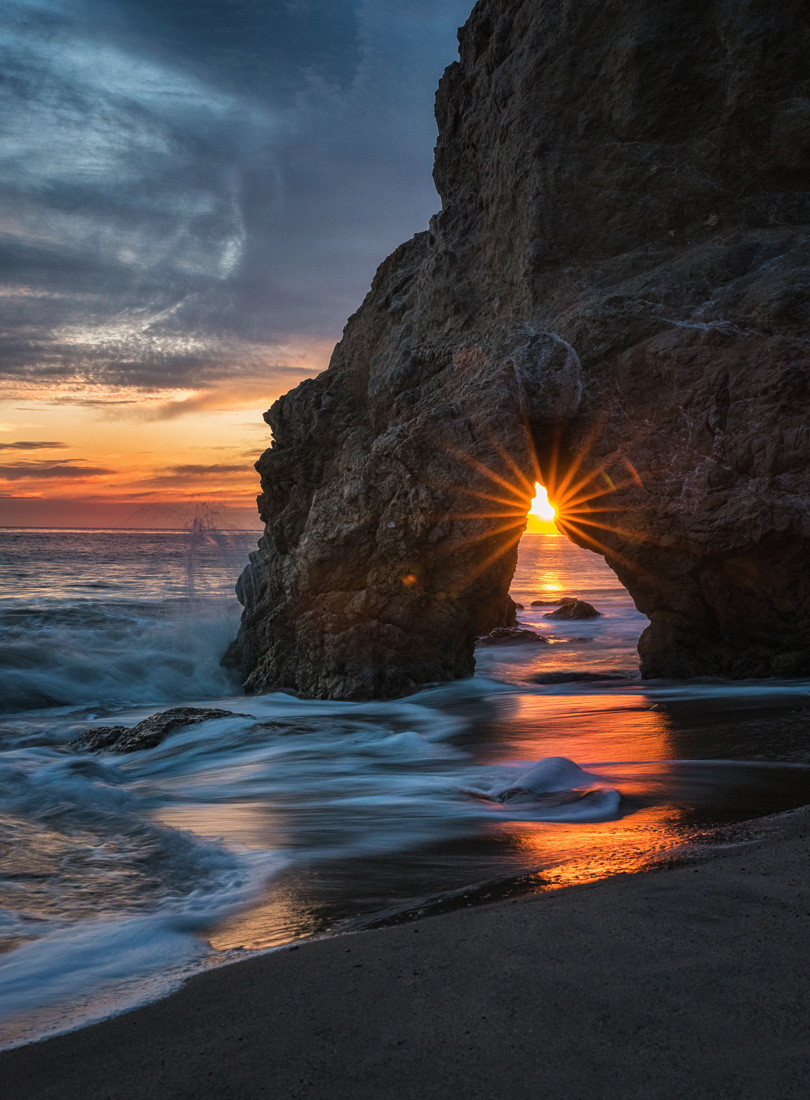 El Matador Beach sea arch at sunset