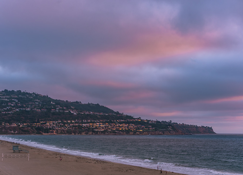 Pink and purple sunset at Torrance Beach in California