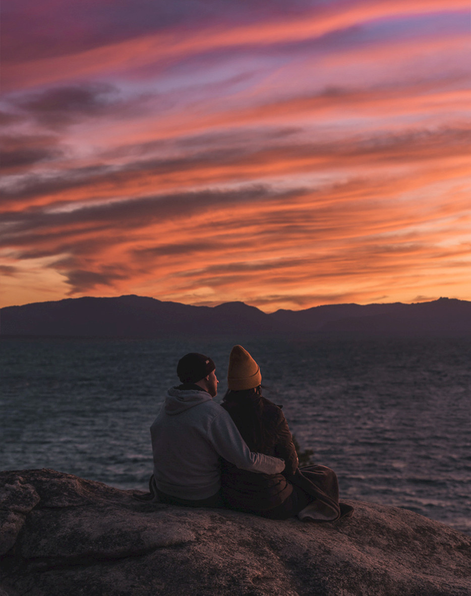 Romantic couple watching a sunset in Lake Tahoe