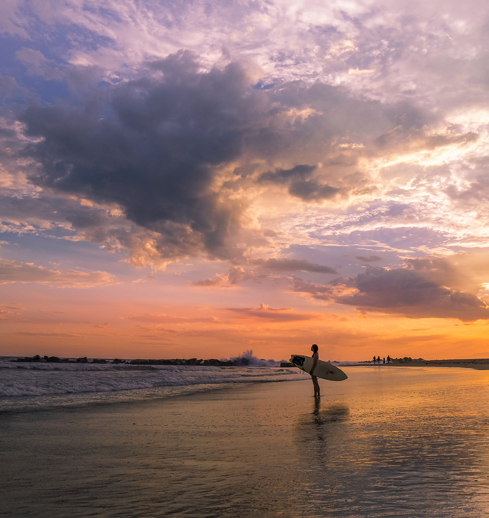 Venice Beach california.  Surfer in Venice Beach at Sunset