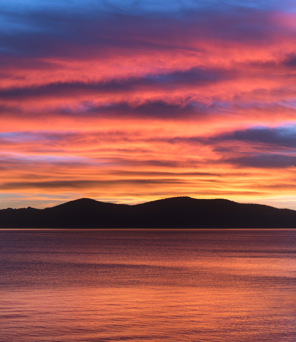 Gorgeous pink sunset captured from the east shore in Lake Tahoe Nevada